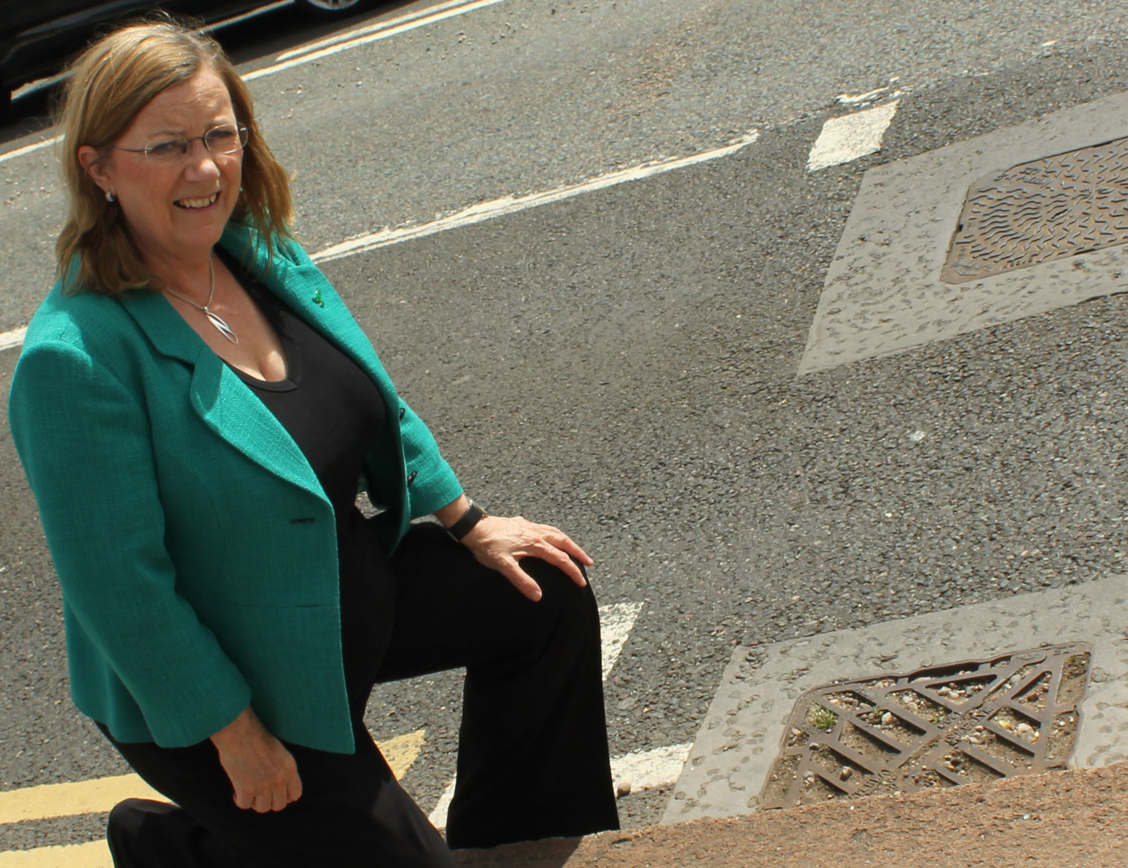 County Cllr Jill Hope at a blocked drain in St James Road on Sunday, 28 July